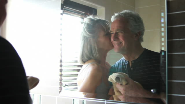 Mature male and female in bathroom video