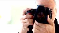 Mature male photographer video