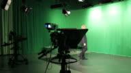 Mature male TV presenter walking into Television studio video