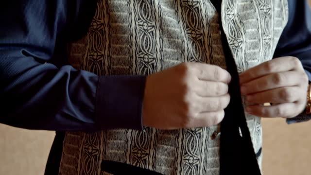 Mature Man Buttoning His Vest Close-Up video