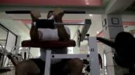 Mature man exercising on sportive equipment video