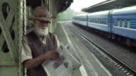 Mature Man Reading A Newspaper video