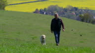 Mature Man Takes Dog For Walk In Countryside Shot On R3D video