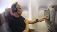 MS Mature man using In-flight entertainment video
