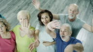 Mature People Waving Their Hands In The Gym video