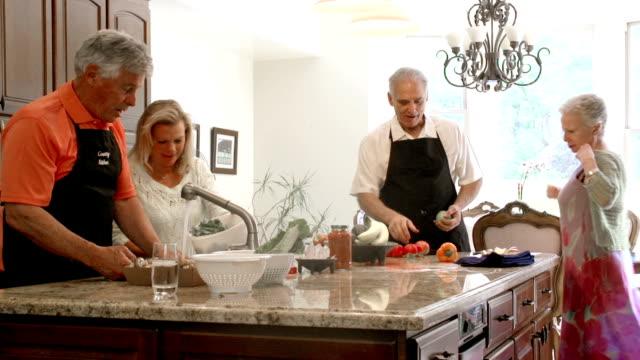 SLOW MOTION - Mature Preparing Food in Kitchen. video