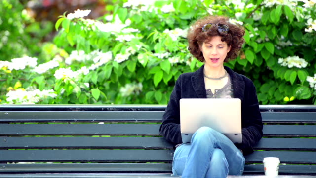 Mature urban casual woman working outdoors video