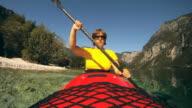 HD SLOW-MOTION: Mature woman enjoy kayaking. video