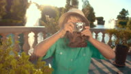 Mature woman holding camera. video
