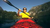 HD SLOW-MOTION: Mature woman kayaking. video
