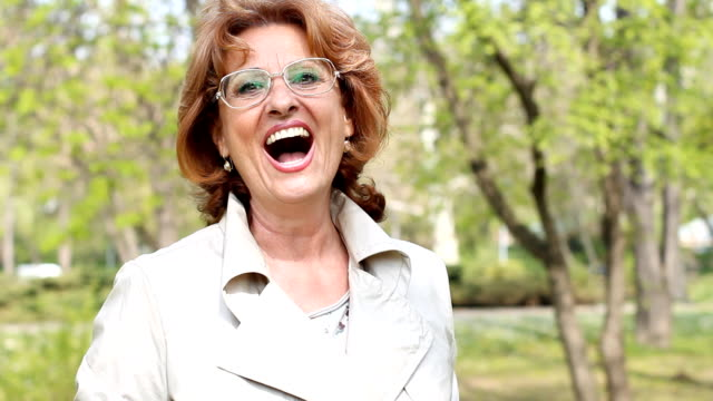 Mature woman laughing video