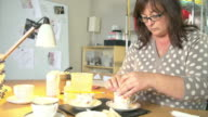 Mature Woman Making Candles In Teacups At Home video