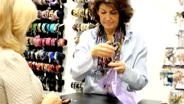 Mature  woman shopping video