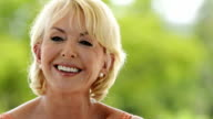 Mature woman smiling video
