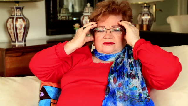 Mature woman suffering a migraine video