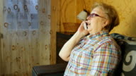 Mature woman talking on mobile phone video