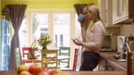 Mature Woman Texting On Mobile Phone At Home Shot On R3D video
