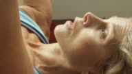 A mature woman works out in her home gym in slow motion. video