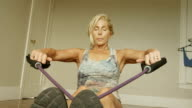 A mature woman works out in her home gym. video