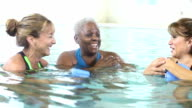 Mature women doing water aerobics, talking, laughing video