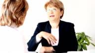 Mature women in business video