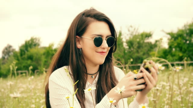 Meadow texting, Sunlight. video