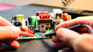 Measure of electronics with digital multimeter. video