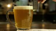 Measurement of the foam's height in a beer mug video
