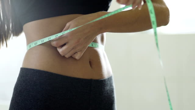 Measuring waistline of a beautiful body in inches  HE video