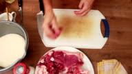 Meat dish - chopping t-bone steak onto small chunks video