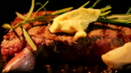 Meat frying in pan with butter, garlic and rosemary video