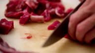 Meat preparing - chopping side steak - closeup video
