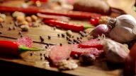 Meat products. Assortment of meats, variety of smoked meats on a wooden board. video
