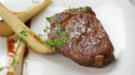 Meat with slices of pear. video