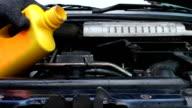 Mechanic Adding Coolant to Car radiators video