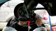Mechanic changes brake pads video