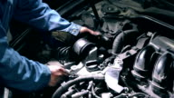 Mechanic changing engine component video