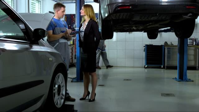 Mechanic Doing A Checklist Of Car Repair video
