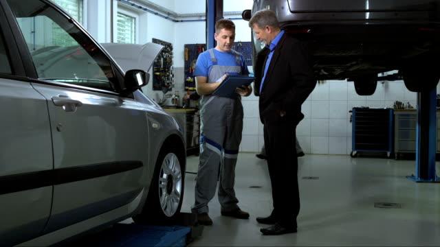 Mechanic Explaining Repairs To Customer video