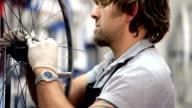 Mechanic fixes bike wheels close up video