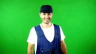 Mechanic / Handyman smiling in front of Green Screen video