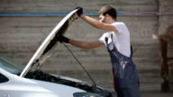 Mechanic looks for errors in the car, car repairs, warranty video