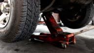 Mechanic Lowers Truck On Floor Jack video