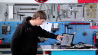 Mechanic moves scheme on touchscreen of tablet video