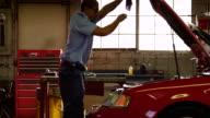 Mechanic opens car hood video
