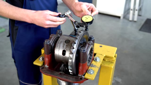 Mechanic repairs a differential video
