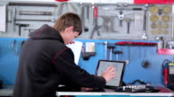 Mechanic takes hex key wrench from the table video