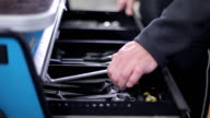 Mechanic takes wrenches from tool box video