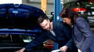 Mechanic talking to a female customer video