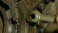 Mechanic tightening the screws. video
